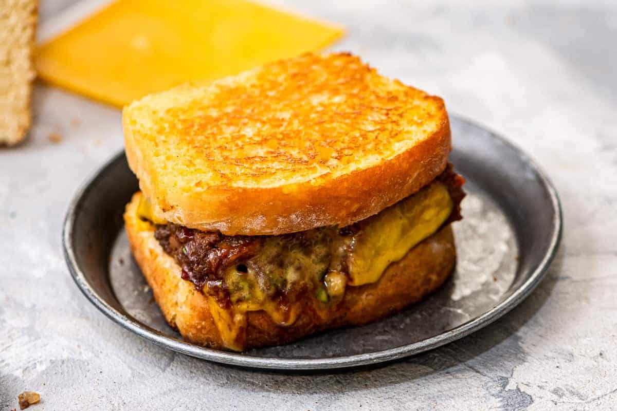 Plate with a toasted meatloaf sandwich