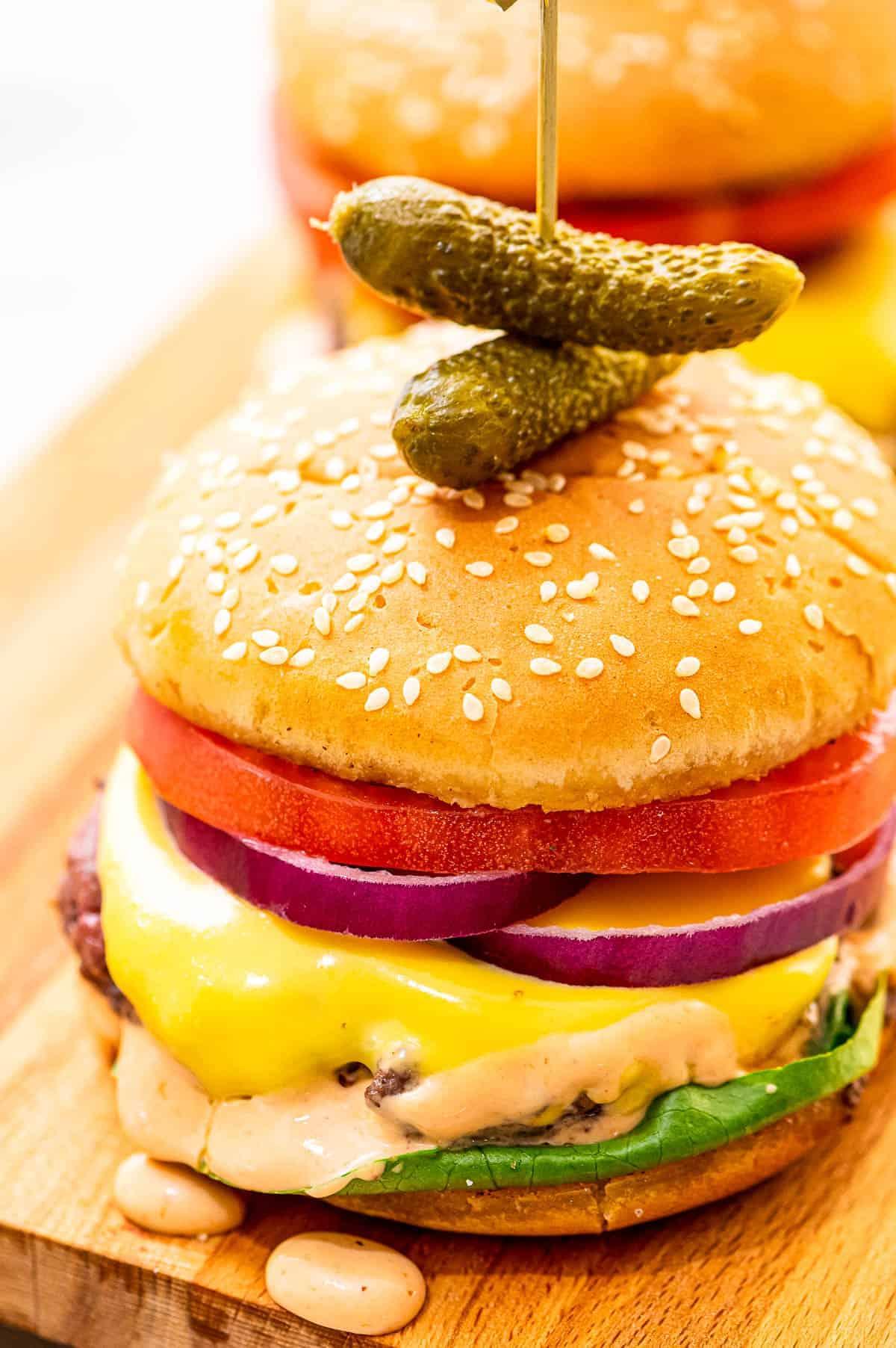 Cheeseburger with condiments on bun